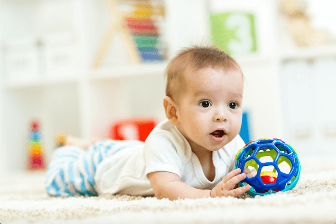 Baby teething - dental clinic margao - best Pediatric dentist goa - baby Pediatric dentist goa - Pediatric dentists in south goa - baby smiling - baby playing - stock images