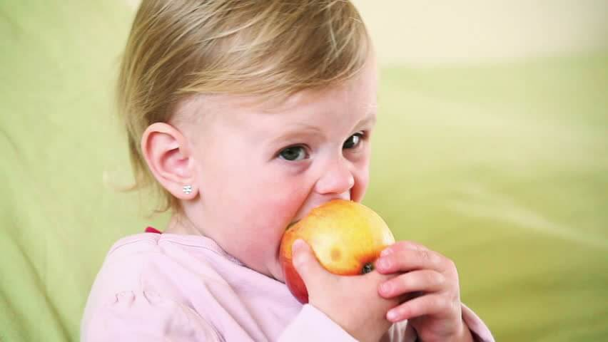 Baby teething - dental clinic margao - best Pediatric dentist goa - baby Pediatric dentist goa - Pediatric dentists in south goa - baby smiling - baby eating apple - baby dental care